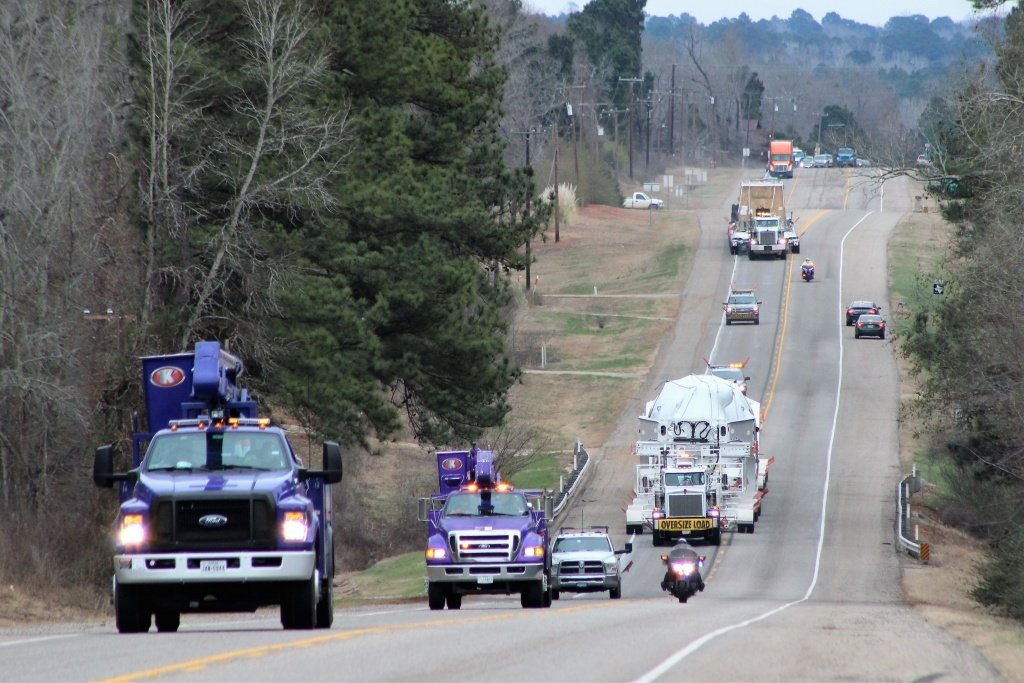 Kenco's purple bucket trucks escorted a steam turbine and generator to Canadian border.